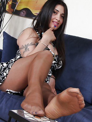 Hot brunette in sheer pantyhose shows her soft soles