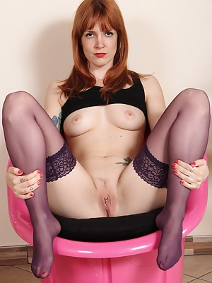Irina Vega in purple stockings plays with a dildo