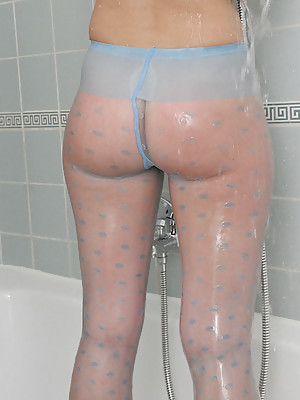 Blond Angel in pantyhose gets wet