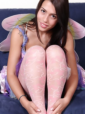 Hot brunette fairy shows her feet and soles in pantyhose
