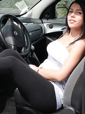 Petra shows her bare feet in pink ballet flats while revving with her car
