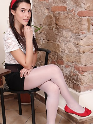 Petra in white pantyhose shows her sexy feet