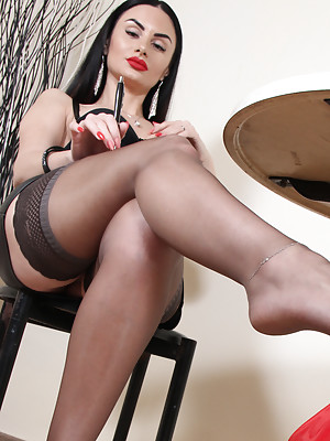Stunning brunette Goddess Ambra in sexy nylons shows her perfect feet