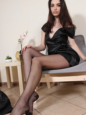 Stunning brunette in nylon pantyhose shows her perfect feet