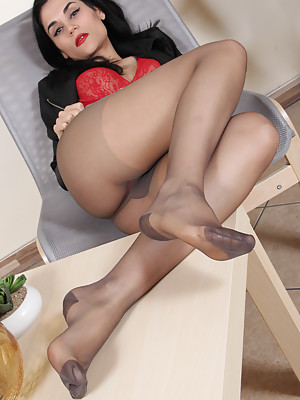 Gorgeous brunette in sexy nylons shows her perfect feet