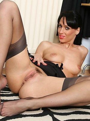 Cheryl strips to her stockings to masturbate in the office