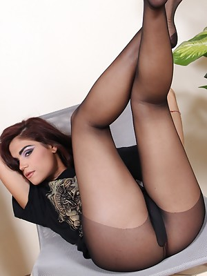 Beautiful alternative girl showing her perfect feet in black pantyhose