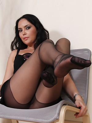 Gorgeous brunette shows her feet in black pantyhose