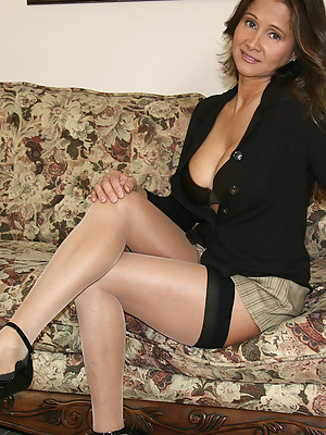 HotWifeRio puts on a pair of sexy stockings then sucks off one of her members