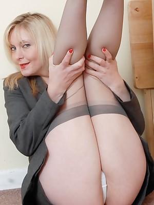 Blonde MILF in gray stockings