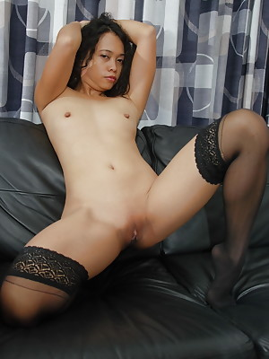 Kimberley, horny Filipino sex doll is teasing and stripping nude on the couch.