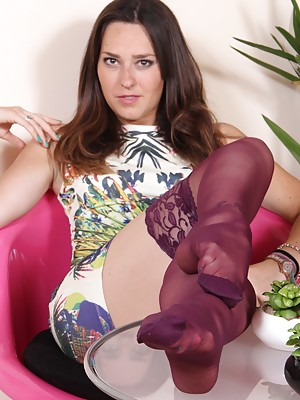 Gorgeous brunette shows her perfect hosed soles