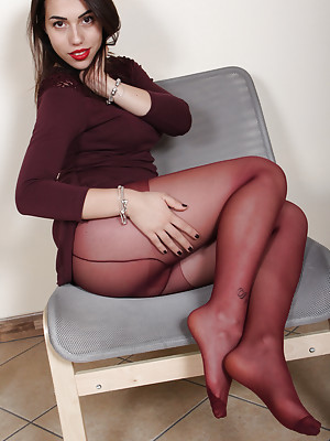 Petra shows her perfect feet in sexy nylons