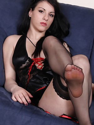 Gorgeous brunette shows her perfect feet and soles