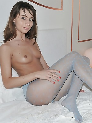 Christina horny in blue pantyhose at home