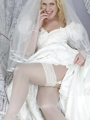 Lara Lee strips from her wedding dress to play in her lingerie