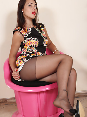 Petra shows her feet in sexy black nylons