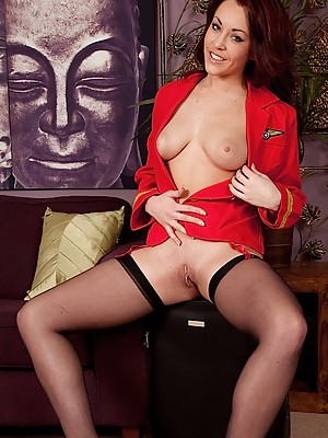 Naughty flight attendant Amy Rose strips naked.