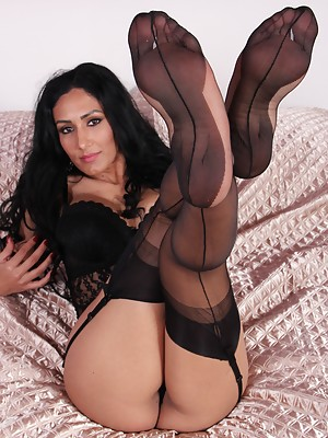 Mistress Alexya shows her soles in black stockings