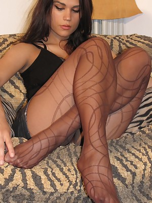 Naughty girl in pantyhose show off her soles