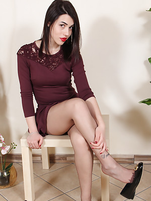 Hot brunette in ballet flats shows her perfect feet in sheer pantyhose
