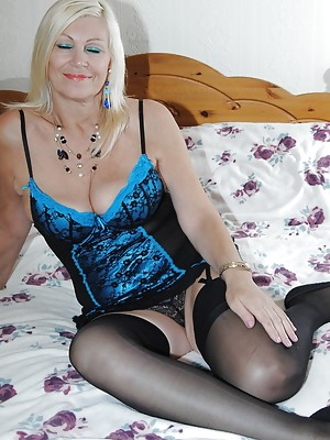 Pictures of Platinum Blonde in blue lingerie and showing her DD tits.