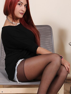 Naughty redhead in black pantyhose