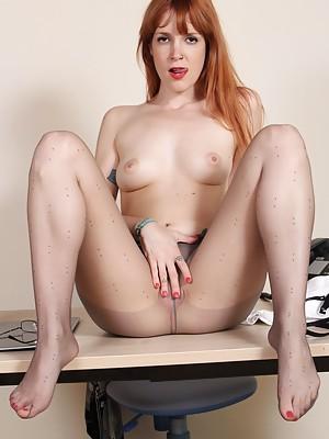 Irina Vega plays with her feet in sheer pantyhose