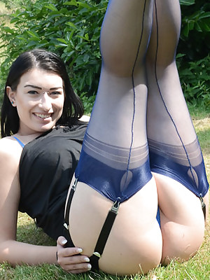 Sexy brunette shoring off her seamed stockings