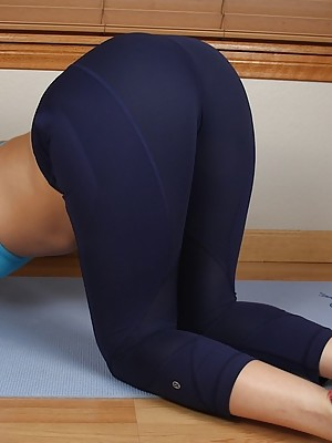 Blonde babe Kate England spreads her ass after her yoga workout.