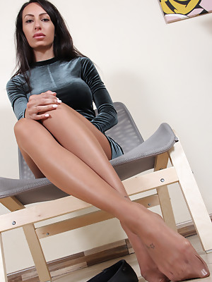 Hot skinny brunette shows her feet in sexy black nylons