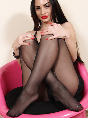 Stunning brunette Goddess Ambra shows her perfect feet in black nylon wolford pantyhose