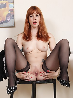 Irina Vega in black nylon stockings shows off her soles