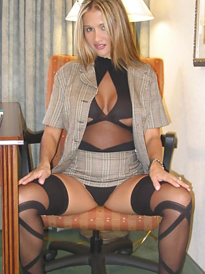 Rio lifting up her business skirt and showing off her sexy stockings
